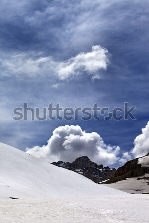 Rocks with clouds and snowy plateau Stock photo © BSANI