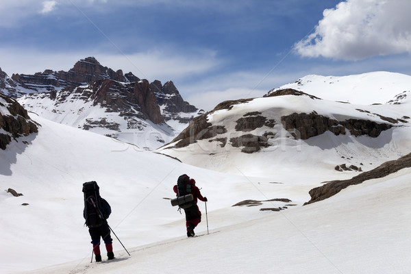Two hikers in snowy mountains Stock photo © BSANI