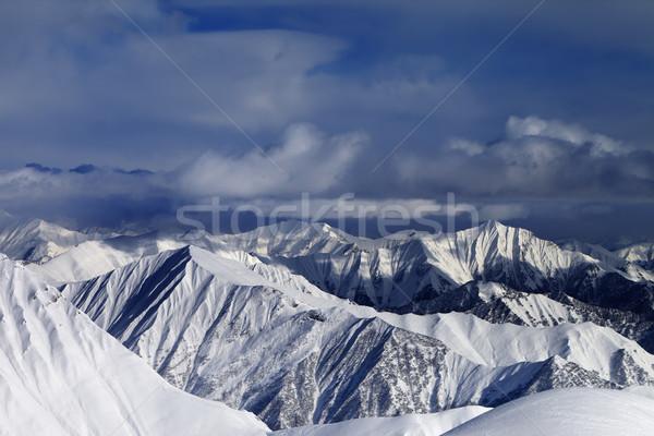 Napfény hegyek viharfelhők Kaukázus Grúzia sí Stock fotó © BSANI