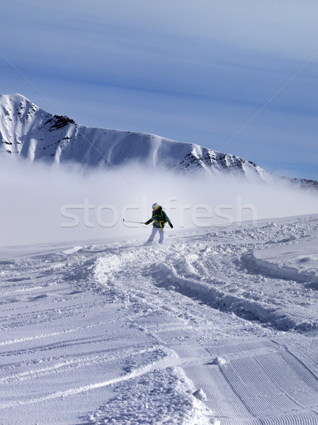 Snowboarder downhill on off-piste slope in sunny day Stock photo © BSANI