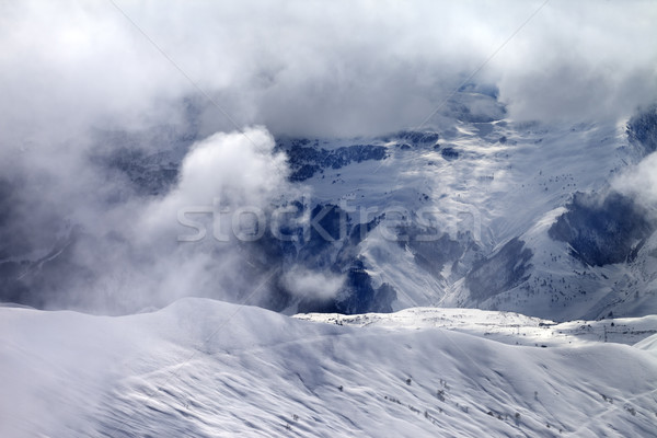 Off-piste slope in sunlight clouds Stock photo © BSANI