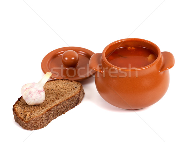 Borsch in clay pot with bread and garlic Stock photo © BSANI
