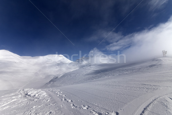 Ski slope with snowmobile trail Stock photo © BSANI