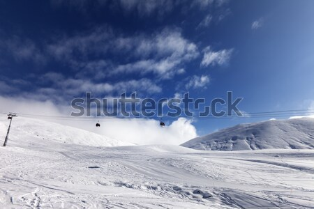 Off-piste slope and blue sky with clouds at sunny day Stock photo © BSANI