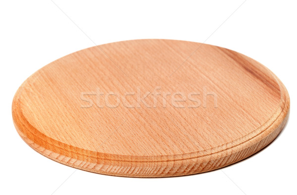 Round wooden kitchen board isolated on white background Stock photo © BSANI