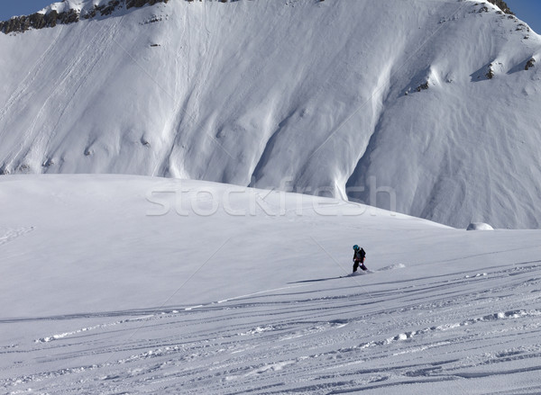 Snowboarder downhill on off piste slope with newly-fallen snow Stock photo © BSANI