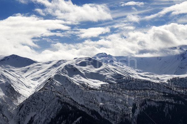 View on snow mountains and cloudy sky in sun evening Stock photo © BSANI