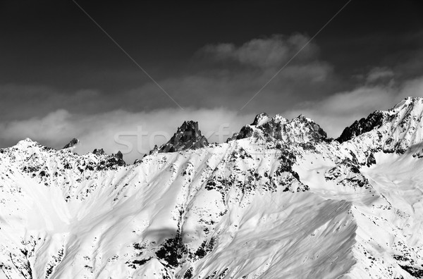 Black and white view on snowy mountains at sun day Stock photo © BSANI