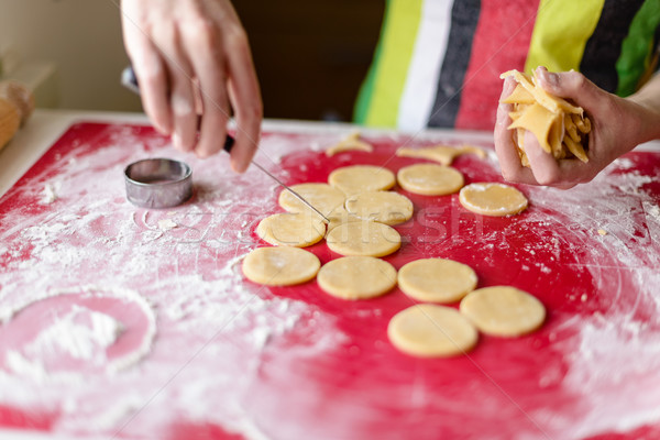 close up of female hands making cookies from fresh dough at home Stock photo © bubutu