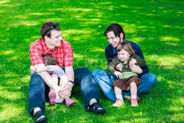 happy family of four sitting on grass Stock photo © bubutu