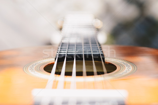 Stock photo: Detail of classic guitar with shallow depth of field