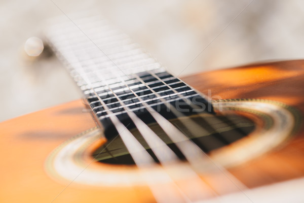 Stock photo: Acoustic guitar bridge and strings close up