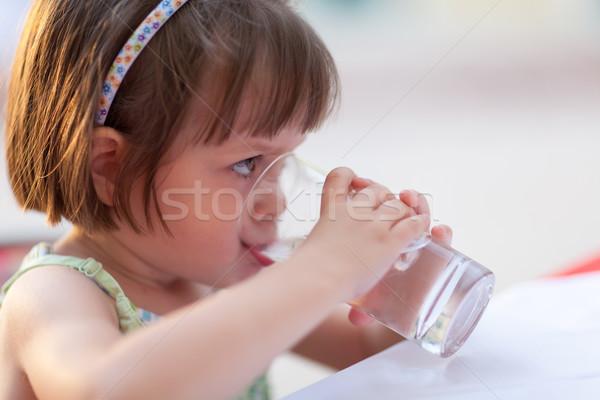 Little girl drinking water outdoors  Stock photo © bubutu