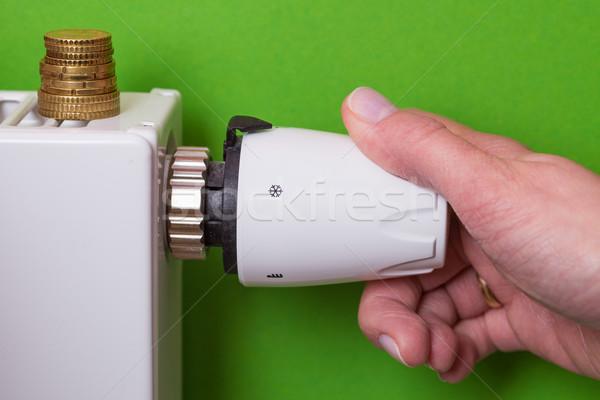 Radiátor termosztát érmék kéz zöld beállítás Stock fotó © bubutu