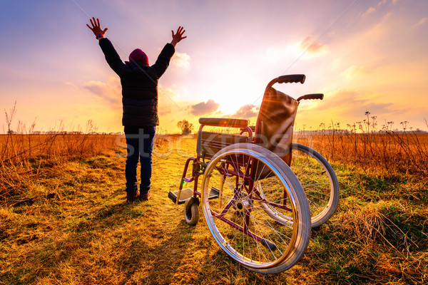 Miracle recovery: young girl gets up from wheelchair and raises  Stock photo © bubutu