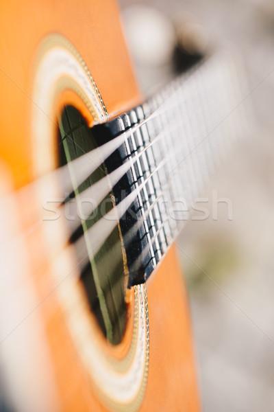 Stock photo: Acoustic guitar bridge and strings close up - macro