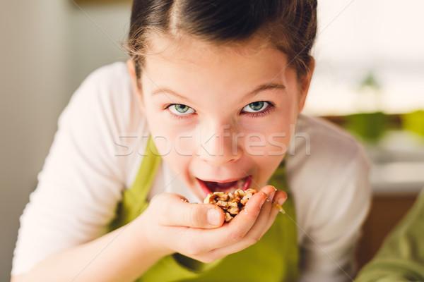 Funny Girl eating walnuts Stock photo © bubutu