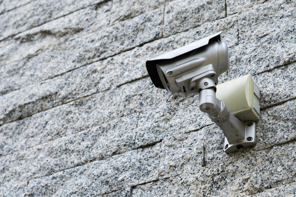 Security Camera on a grey stone wall Stock photo © bubutu