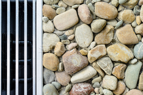 Metal vent grid and stones - background Stock photo © bubutu