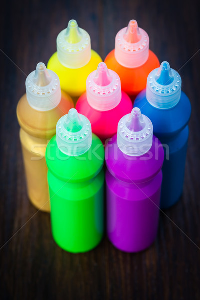 Bottles with colorful dry pigments on wooden background Stock photo © bubutu