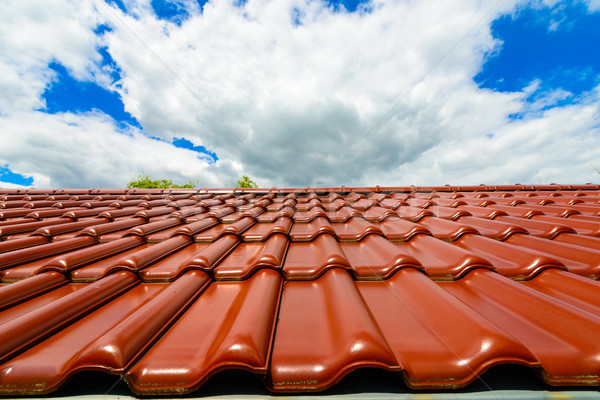 Brand new red rooftop against blue sky Stock photo © bubutu