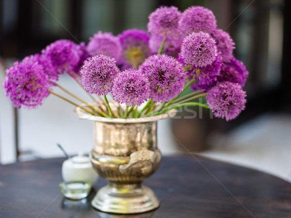 Allium flowers bouquet in a stylish decorative vase Stock photo © bubutu