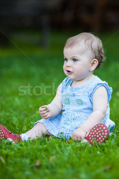 Güzel sevimli mavi elbise oturma Stok fotoğraf © bubutu