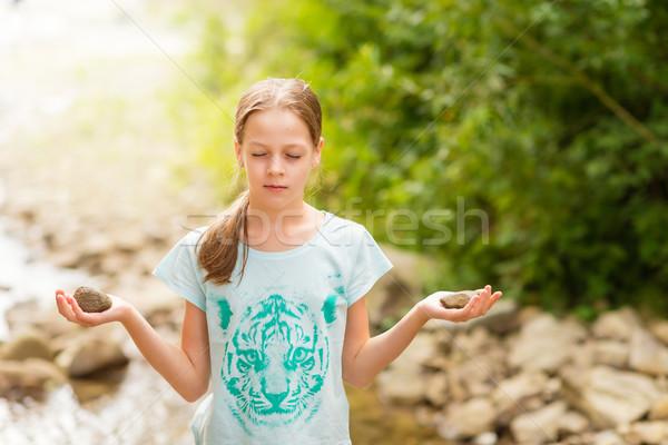 Young Yoga Girl meditating at sunrise Stock photo © bubutu