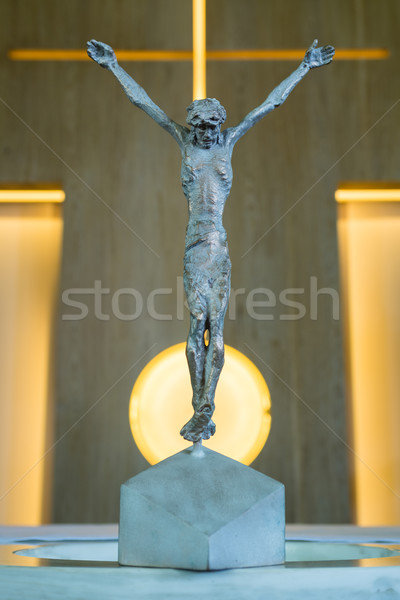 Stock photo: Bronze Statue of Jesus Christ crucified on a cross in a church