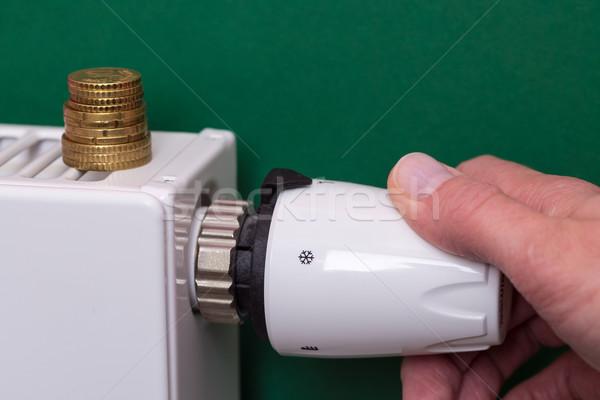 Radiátor termosztát érmék kéz sötét zöld Stock fotó © bubutu