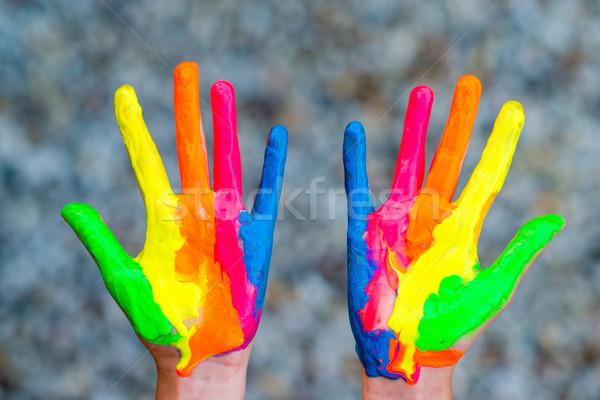 Hands painted in colorful paints ready for hand prints Stock photo © bubutu