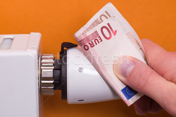 Radiator thermostat, banknote and hand - brown Stock photo © bubutu