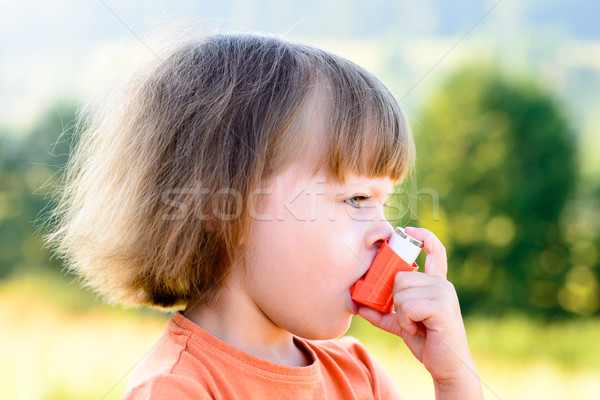 Little girl using inhaler on a sunny day Stock photo © bubutu