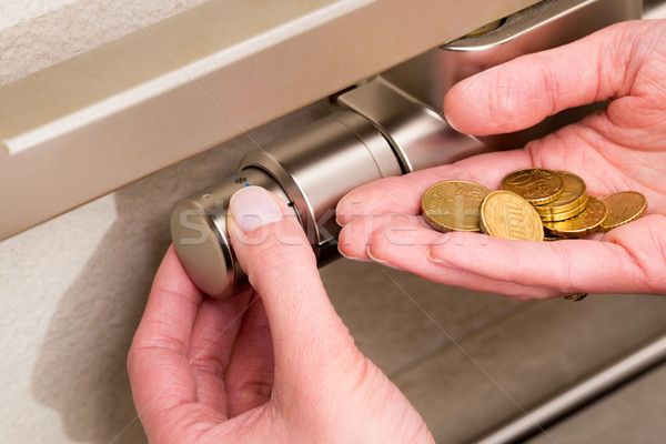 Radiator thermostat, coins and hand Stock photo © bubutu