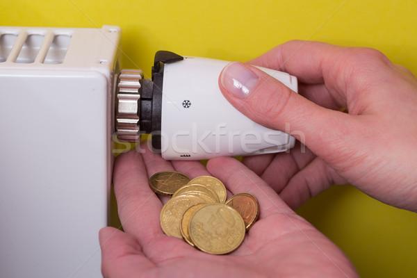Radiátor termosztát érmék kéz citromsárga beállítás Stock fotó © bubutu