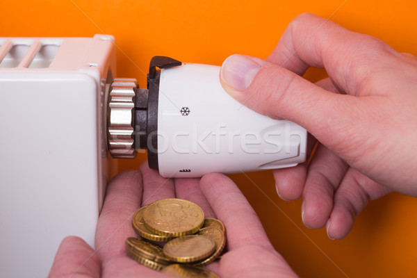Radiátor termosztát érmék kéz narancs beállítás Stock fotó © bubutu