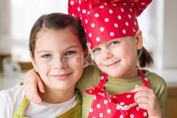 Happy sisters cooking together Stock photo © bubutu