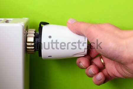 radiator thermostat and hand - (red) Stock photo © bubutu