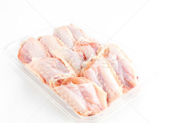 fresh Chicken middle wings in package on white background Stock photo © Bunwit