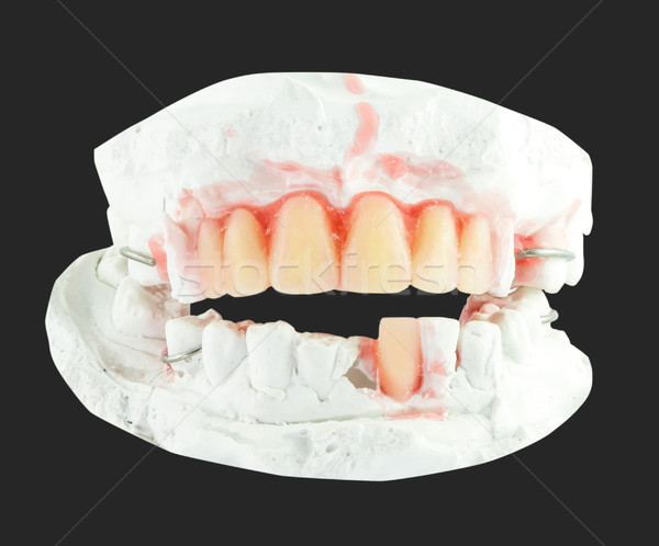 upper and lower denture teeth with  wax model isolate Stock photo © Bunwit