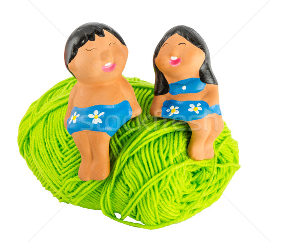 doll on green yarn Stock photo © Bunwit