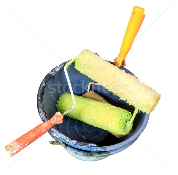colorful paint roller in paint bucket. Stock photo © Bunwit