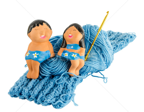 doll on fragment blue knitting cloth Stock photo © Bunwit