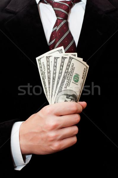 Empresário dólares mãos papel terno financiar Foto stock © burtsevserge