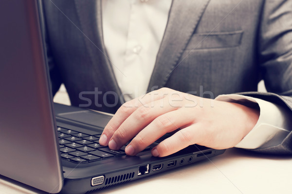 Stock photo: Man's Hands Typing On Laptop Keyboard