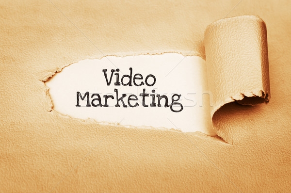 Video pazarlama yazılı arkasında yırtık kağıt kâğıt Stok fotoğraf © burtsevserge