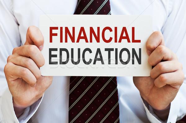 Pénzügyi oktatás üzletember tart kártya üzenet Stock fotó © burtsevserge
