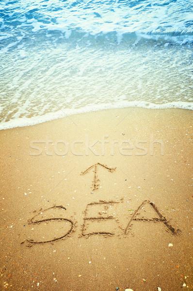 Deniz ok yazılı kum plaj su Stok fotoğraf © burtsevserge
