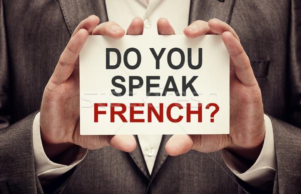 Parlare francese uomo indossare suit Foto d'archivio © burtsevserge