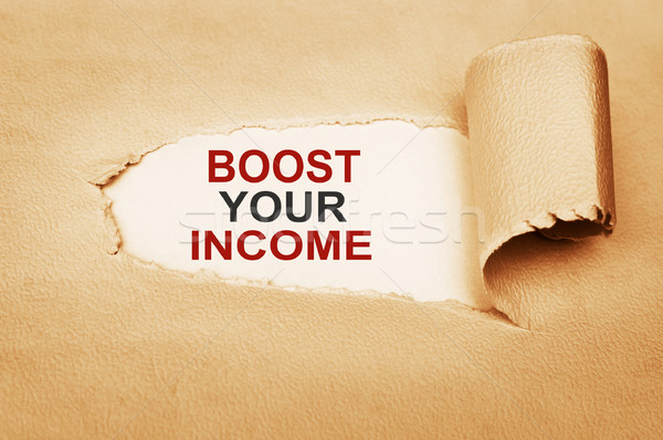 Boost Your Income Behind Torn Paper Stock photo © burtsevserge